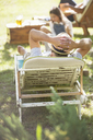 Older man relaxing on lawn chair - CAIF17297
