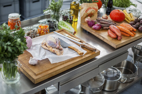 Uncooked filled chicken and different ingredients on chopping board - KVF00100