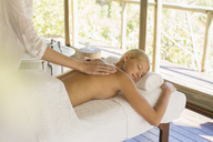 Woman having massage at spa - CAIF17354