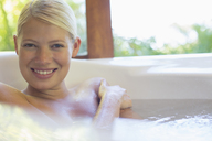 Woman relaxing in hot tub - CAIF17375