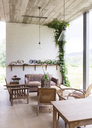 Sofa, chairs and table in rustic living room - CAIF17551