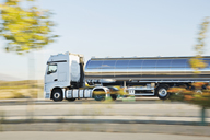 Stainless steel milk tanker on the road - CAIF17575