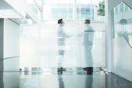 Businessmen talking in modern office - CAIF17599