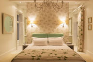 Luxury bedroom with illuminated sconces - CAIF17818