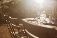 Place settings on sunny tranquil patio table - CAIF17854