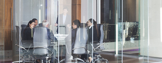 Business people talking in meeting - CAIF17920