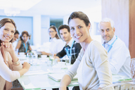Business people smiling in meeting - CAIF17926