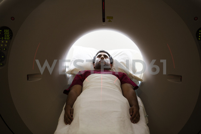 High angle view of patient undergoing MRI scan in hospital - CAVF09285