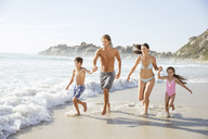 Family running together in waves - CAIF18058