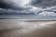 Clouds over beach at low tide - CAIF18076