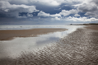 Clouds over beach at low tide - CAIF18079