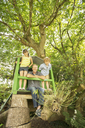 Father and children playing in treehouse - CAIF18106