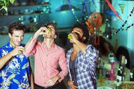 Men taking shots at party - CAIF18184
