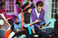 Couple playing records at party - CAIF18202
