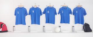 Soccer team uniforms in locker room - CAIF18319