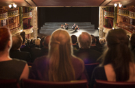 Audience watching quarter perform on stage in theater - CAIF18412