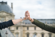 France, Paris, young couple holding hands - TAMF00947