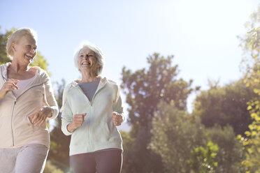 Senior women running outdoors - CAIF18593
