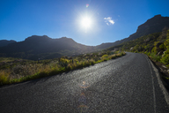Spain, Canary Islands, Gran Canaria, empty road in sunshine - STCF00424