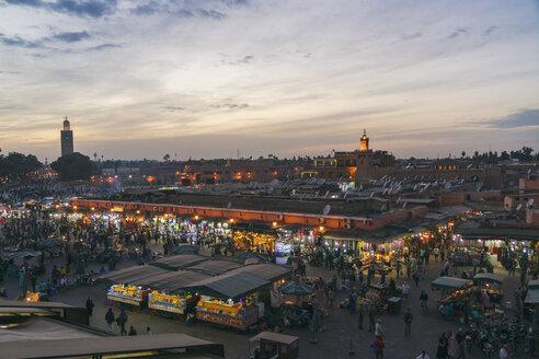 Morocco, Marrakesh, view to Jemaa el-Fnaa bazaar in the evening - TAMF00965
