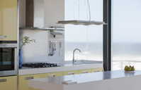 Modern kitchen overlooking ocean - CAIF18803
