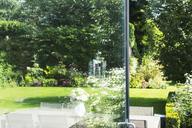 View of landscaped garden through open door - CAIF18941