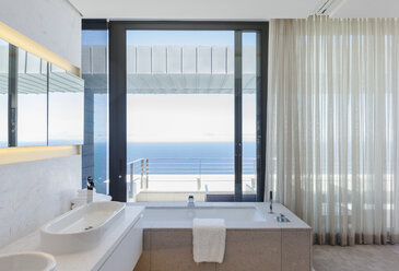 Modern bathroom overlooking ocean - CAIF18962