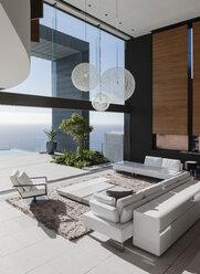 Modern living room overlooking ocean - CAIF18989