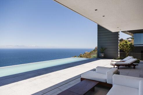 Modern patio overlooking ocean - CAIF18992