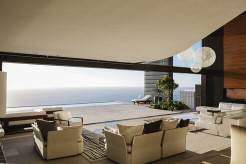 Modern living room overlooking ocean - CAIF19022