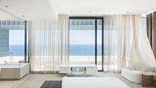 Modern bedroom overlooking ocean - CAIF19031