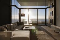Modern living room overlooking ocean - CAIF19052