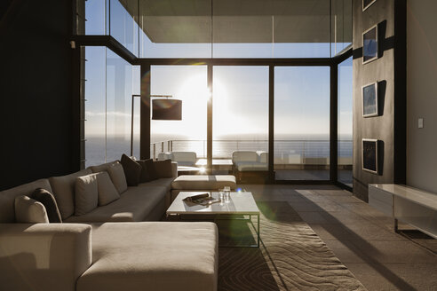 Modern living room overlooking ocean - CAIF19052