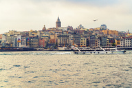 Turkey, Istanbul, view to Galata Tower, Golden Horn and tourboat - TAMF00977