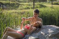 Happy couple enjoying at lakeshore - CAVF09926