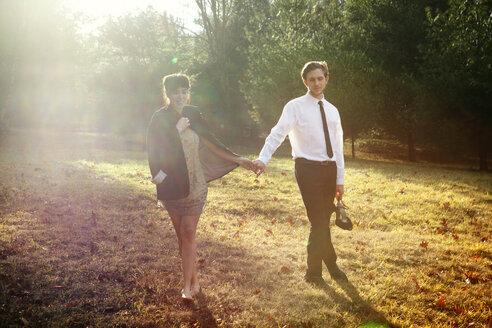 Couple walking on field - CAVF09998