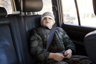 Portrait of boy sitting in car - CAVF10091
