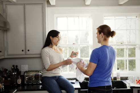 Couple washing dishes in kitchen at home - CAVF10211