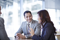 Business people talking in meeting - CAIF19464