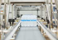 Water bottles on conveyor belt in factory - CAIF19571