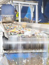 Recycled material on conveyor belt in recycling center - CAIF19583