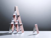 Small house of cards next to large house of cards - CAIF19697