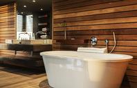 Bathtub and sink in modern bathroom - CAIF19823