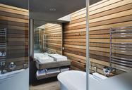 Sinks and bathtub in modern bathroom - CAIF19826