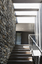Stairs and stone wall in modern house - CAIF19829