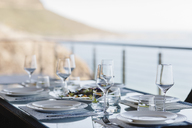 Set table on luxury patio - CAIF19844