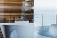 Bathtub and glass door in modern bathroom - CAIF19850