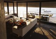 Modern living room overlooking ocean - CAIF19856