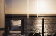 View of sunset reflecting on ocean - CAIF19859