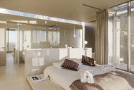 Bed and bathroom in modern master bedroom - CAIF19934